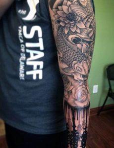 black and white Koi Fish Tattoo Design on Arm